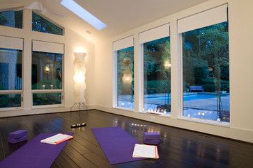 Black wood floors and white framed windows with simple lighting // 7 Yoga Rooms That Will Instantly Relax You (PHOTOS)