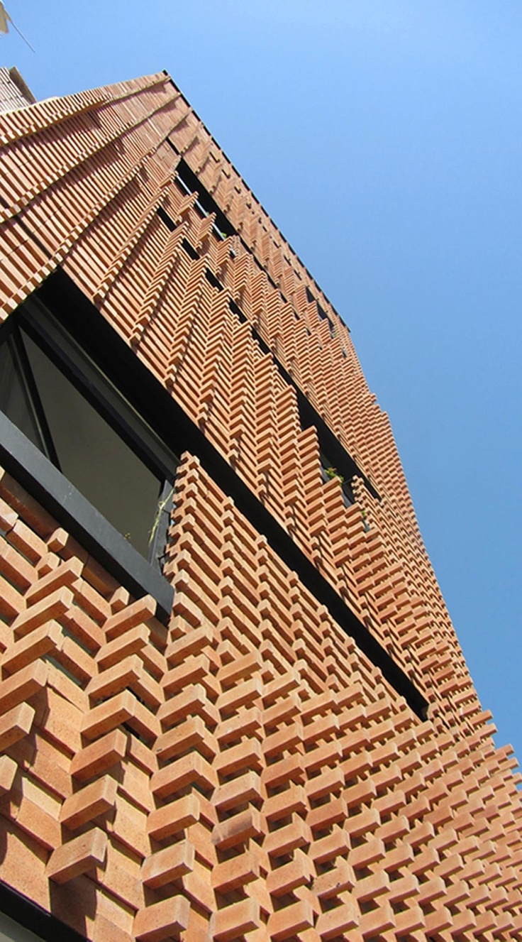 2x wood screen highly textured exterior wall treatment screens slats perforations fins Materials for exterior walls