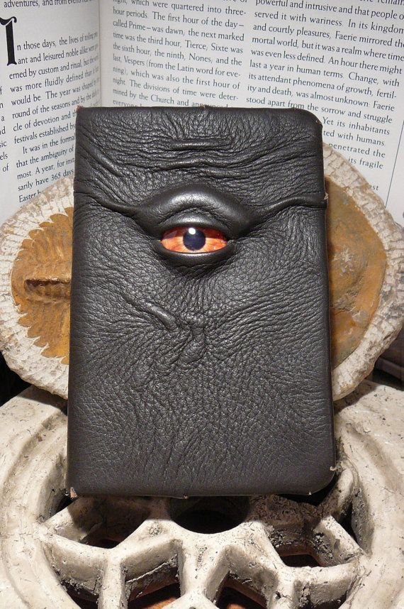 Mythical Beast Book (Chocolate Brown leather with Orange eye). $35.95, via Etsy.