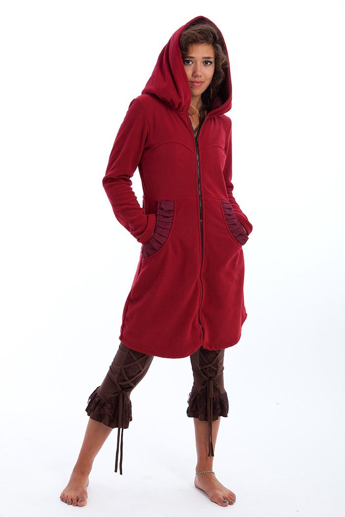 Fleece coat with large hood and round pockets.