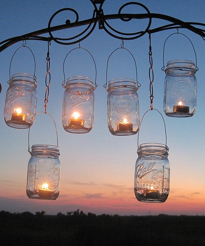 Im gonna make these, just adding some sand in the bottom first, then hang around the porch.