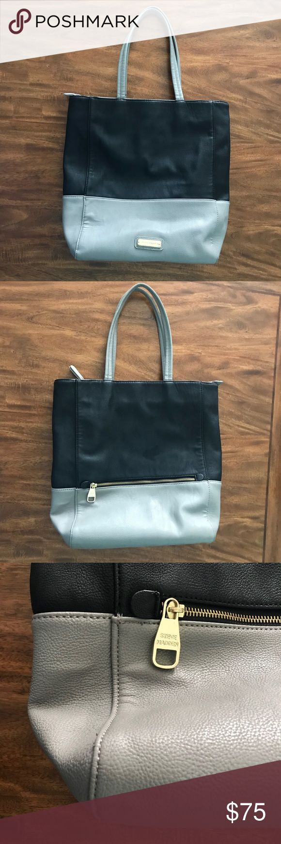 Steve Madden Zip Top Tote Faux Leather Two Tone Excellent used condition. No stains I could see inside, none outside except one tiny mark on the bottom shown in the last photo. The main logo on the front has a few scratches. Not super noticeable. This bag is super easy to clean. Can hold lots of stuff with pockets inside and one zipper pocket outside as well. It can fit my laptop as well as several other books. Only selling because I have so many bags. Steve Madden Bags Totes