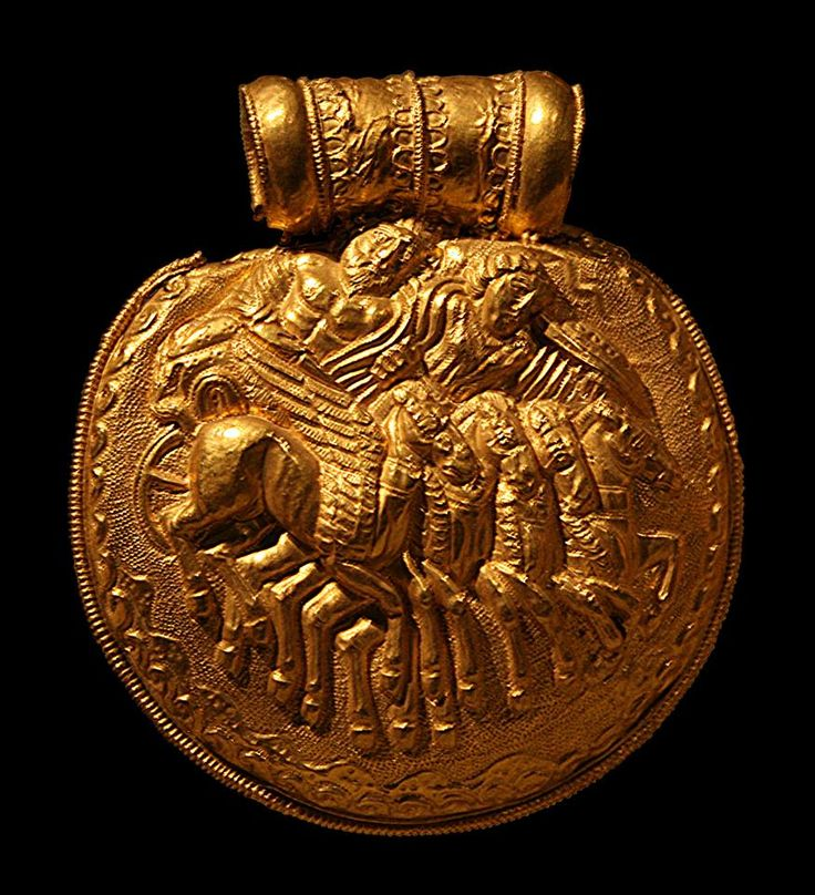 Etruscan embossed bulla of polished gold depicting a chariot race and their charioteer drawn by four winged horses. Vulci -C.400 BCE Gregorian Etruscan Museum