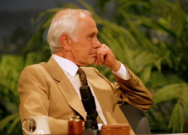 """Talk show host Johnny Carson listens to Bette Midler sing him a farewell love song during the second-to-last taping of """"The Tonight Show"""" in Burbank, Calif. With his debut as host of NBC's """"The Tonight Show"""" 50 years ago this October, until he retired from the show on May 22, 1992, he was seen by more people on more occasions than anyone else in American history. """"Johnny Carson: King of Late Night,"""" a two-hour """"American Masters""""  premiers 14-MAY-12, Monday at 9 p.m. EDT on PBS"""