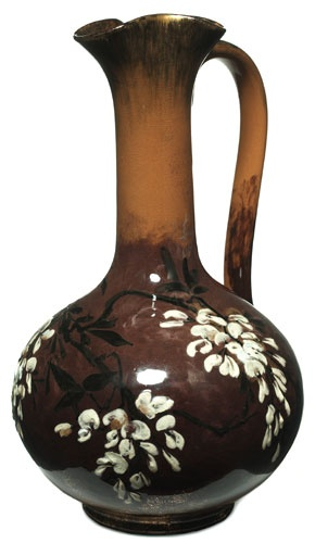 Rookwood ewer by Laura Anne Fry, 1884. Limoges glaze with painted wisteria decoration in underglaze slip. Height 12 inches.