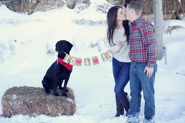 Romantic snowy winter engagement session (with the couple's adorable dog!) / Kate Wenzel Photography { See it on WW: http://www.woodsyweddings.com/2014/03/31/cute-cozy-winter-engagement-session-in-the-snow/ } engagement photos with bunting banner save the date