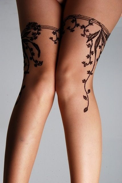 Sexy Tattooed Legs.   Think would look good as arm band, with the vining wrapping around and ending at wrist.