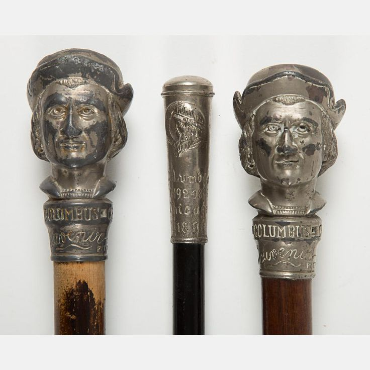 A Group of Three Wooden Walking Sticks with Cast Metal Knobs from the World's Fair Columbian Exposition, Chicago, 1893,Two with the bust of Christopher Columbus