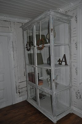 A cabinet made of old windows