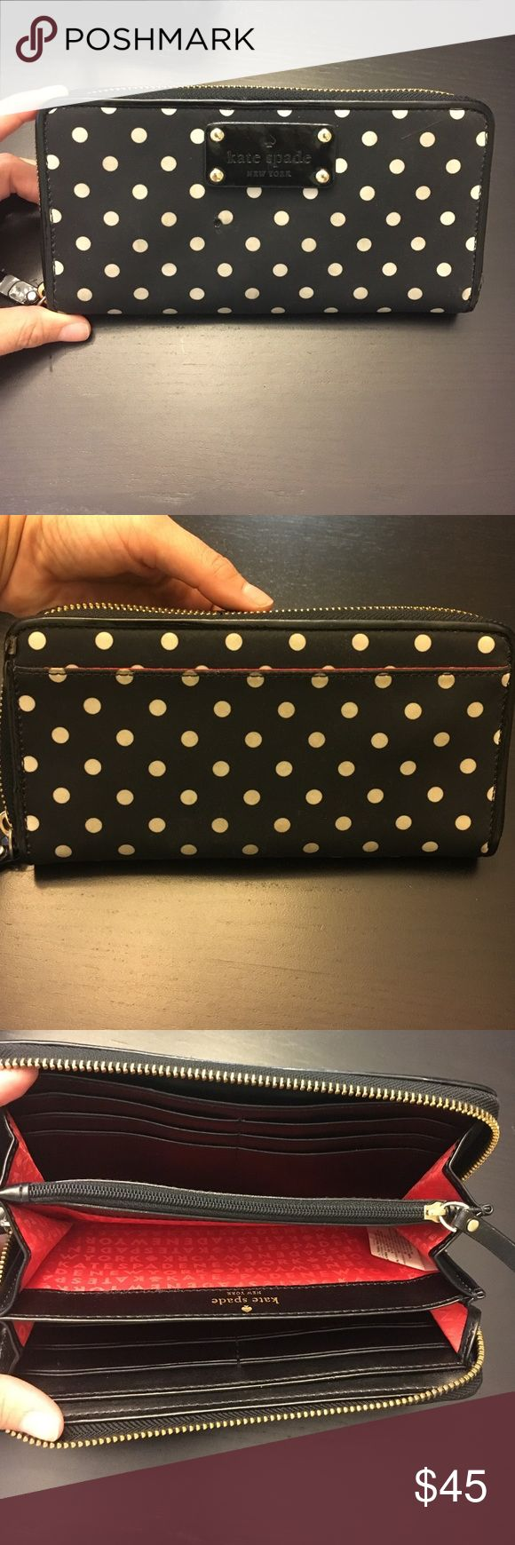 KATE SPADE polka dot zip up wallet! Great condition inside and out! The only thing is this wallet has a very small hole in the front that you can barely see because it's black but just to let you know that it's there! Such a cute wallet especially if you love polka dots! kate spade Bags Wallets