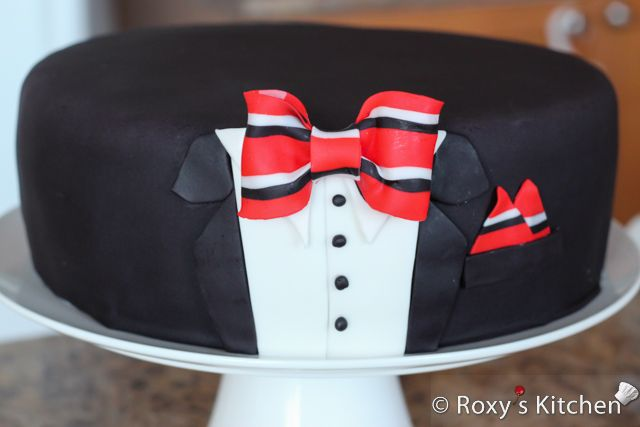 Tuxedo Cake with Striped Bow Tie - Place some edible glue on the back of the bow tie and place it onto the shirt collar.