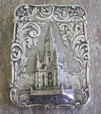 "English sterling silver ""castle top"" calling card case, in very high relief - this case depicts the Scott monument in Edinburgh, Scotland. Made by Nathaniel Mills, Birmingham, c1845"