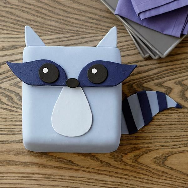 Raccoon Bandit Cake - Finally the tables have turned. The raccoon isn't eating your food – you're eating the raccoon! Use Decorator Preferred™ fondant and icing colors to easily create this little critter.