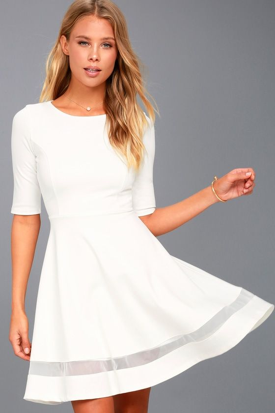 Take your look to trendy new heights with the Sheer Factor White Mesh Skater Dress! Medium-weight knit is formed to half sleeves and a princess-seamed bodice with rounded neckline. Fitted waist leads into a skater skirt with sheer mesh trim along the hem. Hidden back zipper.