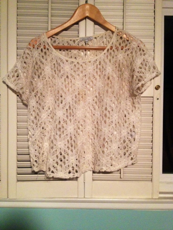 Boxy flower lace top from Delias, size small. This top has a boxy, loose fit and is made of a thicker lace with a flower pattern