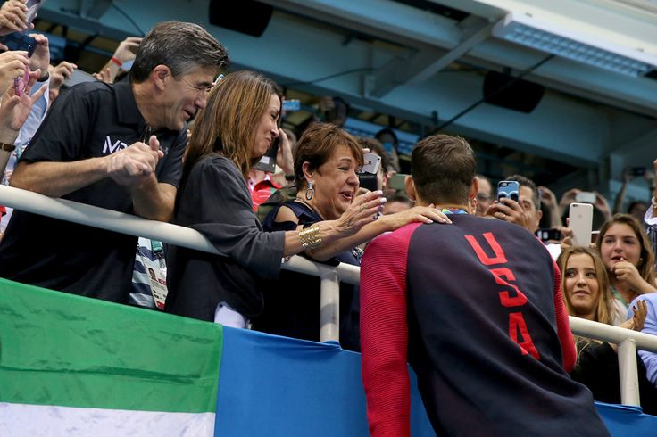 Michael Phelps Photos Photos - Gold medalist Michael Phelps of the United States celebrates with his mother Deborah Phelps, fiancee Nicole Johnson and son Boomer during the medal ceremony for the Men's 200m Butterfly Final on Day 4 of the Rio 2016 Olympic Games at the Olympic Aquatics Stadium on August 9, 2016 in Rio de Janeiro, Brazil. - Swimming - Olympics: Day 4