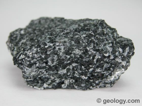 Amphibolite is a non-foliated metamorphic rock that forms through recrystallization under conditions of high viscosity and directed pressure. It is composed primarily of amphibole and plagioclase, usually with very little quartz. The specimen shown above is about two inches (five centimeters) across.
