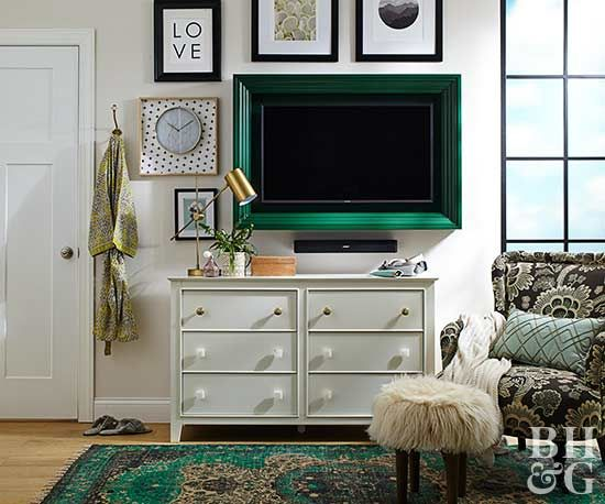 Turn a TV into a piece of art by surrounding it with a chunky painted frame.