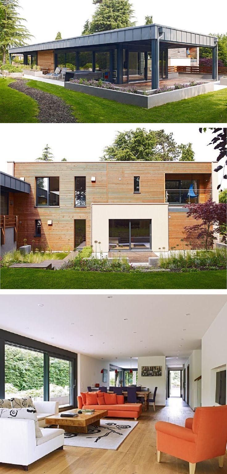 Modernes Holzhaus mit Flachdach - Design-Haus Smith von Baufritz - Fertighaus bauen moderne Architektur mit Holzfassade und Flachdach-Anbau - HausbauDirekt.de