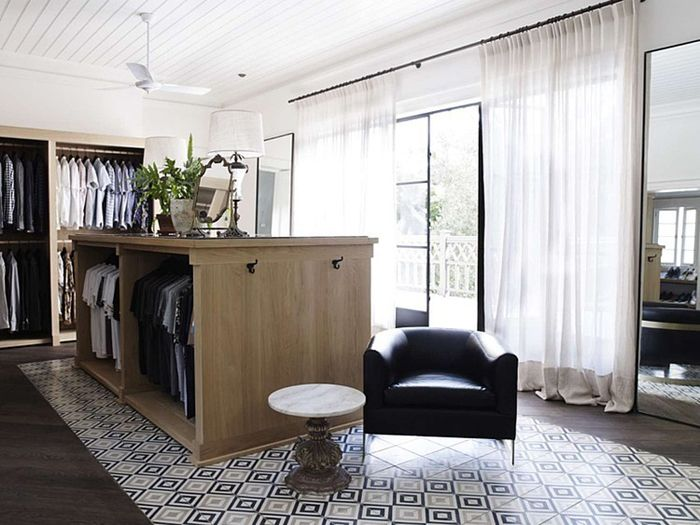 Freestanding closet design by hess|hoen with tile flooring. Photo by Prue Ruscoe