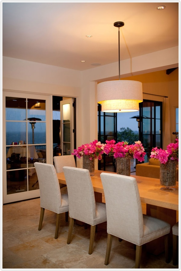 Awesome dining area....table, chairs, light fixture, flower decorations dining-room
