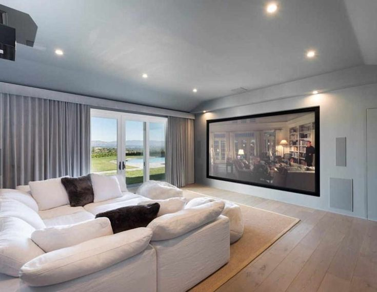 Movie Room from Scott Disick's Hidden Hills Home  Amenities on top of amenities! An in-house movie theater completes the first floor, which also includes a Jr. Master suite and two additional bedrooms.