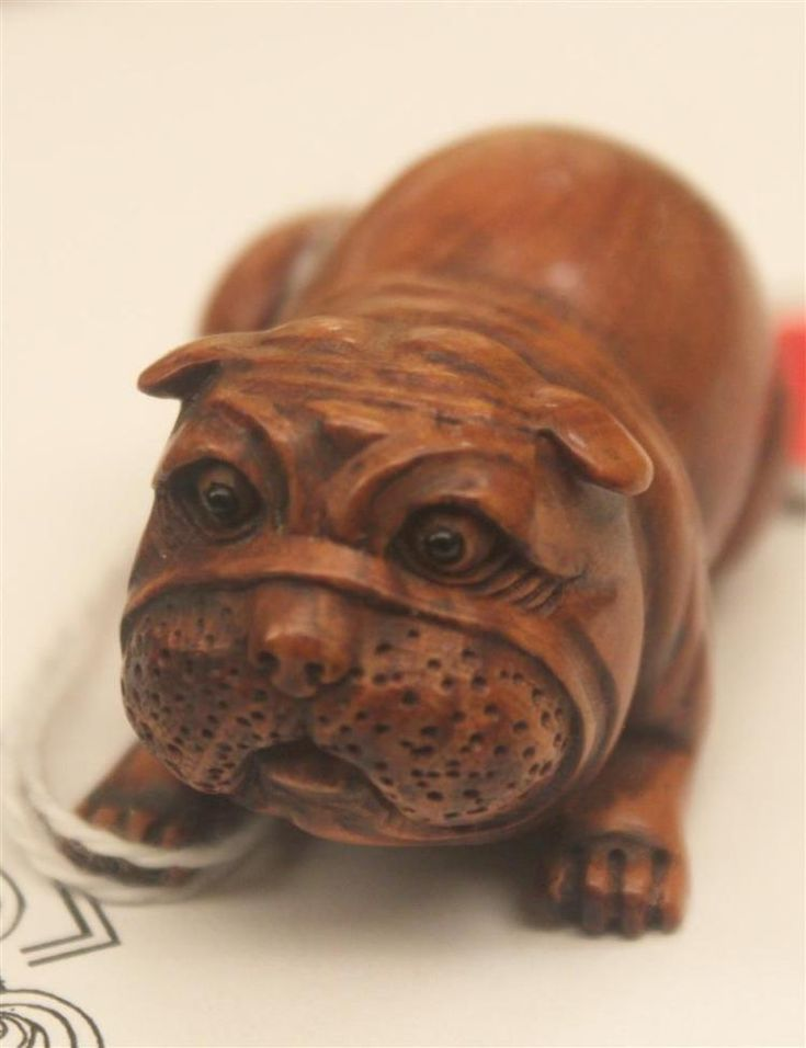 Buy online, view images and see past prices for WOOD NETSUKE By Gyokumatsu. In the form of a reclining dog with comic expression and inlaid eyes. Signed. Length 2.1
