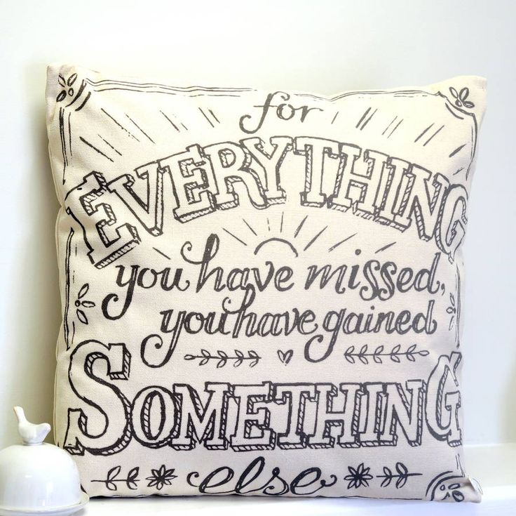 """A natural coloured, cotton canvas cushion with black text.A gorgeous, natural cotton canvas cushion with a beautiful saying printed into it in a mix of vintage style types in grey print, The cushion say's """"for everything you have missed you have gained something else"""". The saying is framed in a pretty printed border and the design also includes flower detail. This cushion is a lovely addition to your bedroom or living room and would make a really nice gift too.Cotton canvas cover. Polyester…"""