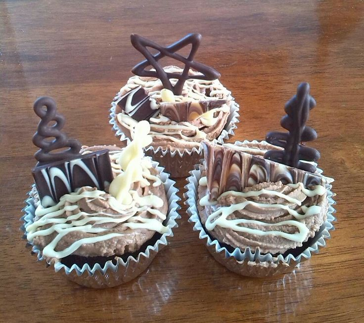 Chocolate cupcakes with whipped ganache and handmade chocolate decorations made by Me
