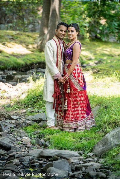 Red and purple bridal lehenga