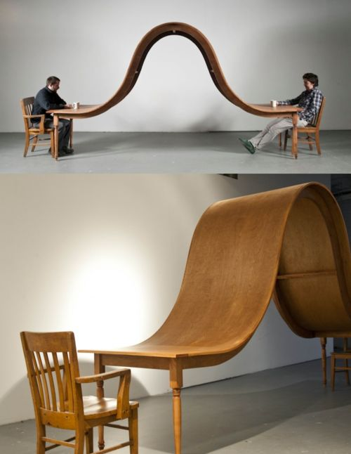 Avoid conversation dining table by Michael Beitz ..... truly weird