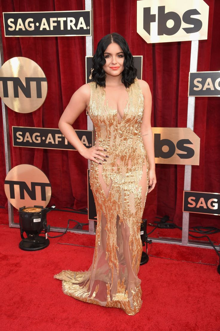 Wow! 'Modern Family' star Ariel Winter dazzled in one of her best red carpet looks to date. The actress was a total stunner in a see-through gold gown with a plunging neckline that showed off her cleavage. She kept her short tresses in waves while rocking a bold red lip. (Photo by Dimitrios Kambouris/Getty Images for TNT)  via @AOL_Lifestyle Read more: https://www.aol.com/article/entertainment/2017/01/29/sag-awards-2017-red-carpet-arrivals/21702677/?a_dgi=aolshare_pinterest#fullscreen