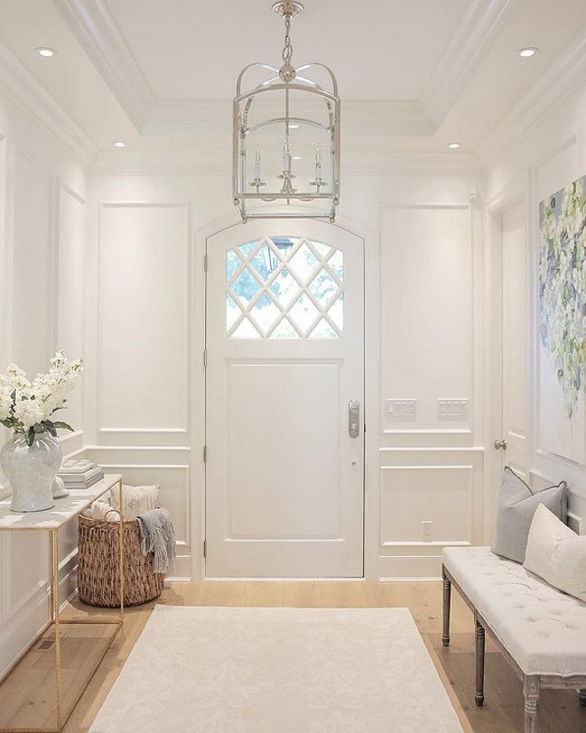 White Foyer With Paneled Walls, White Oak Floors And Circa Lighting Arched  Top Lantern.