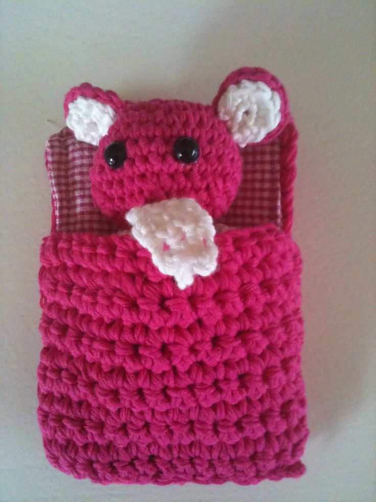 Crochet mouse with sleeping bag.