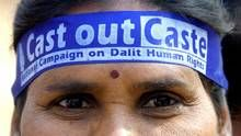 "Timeline: A brief history of India's caste system. If the shadow of a dalit passed over a brahmin, they would become ""unclean,"" so dalits were forced to lay face down on the ground when a brahmin approached."