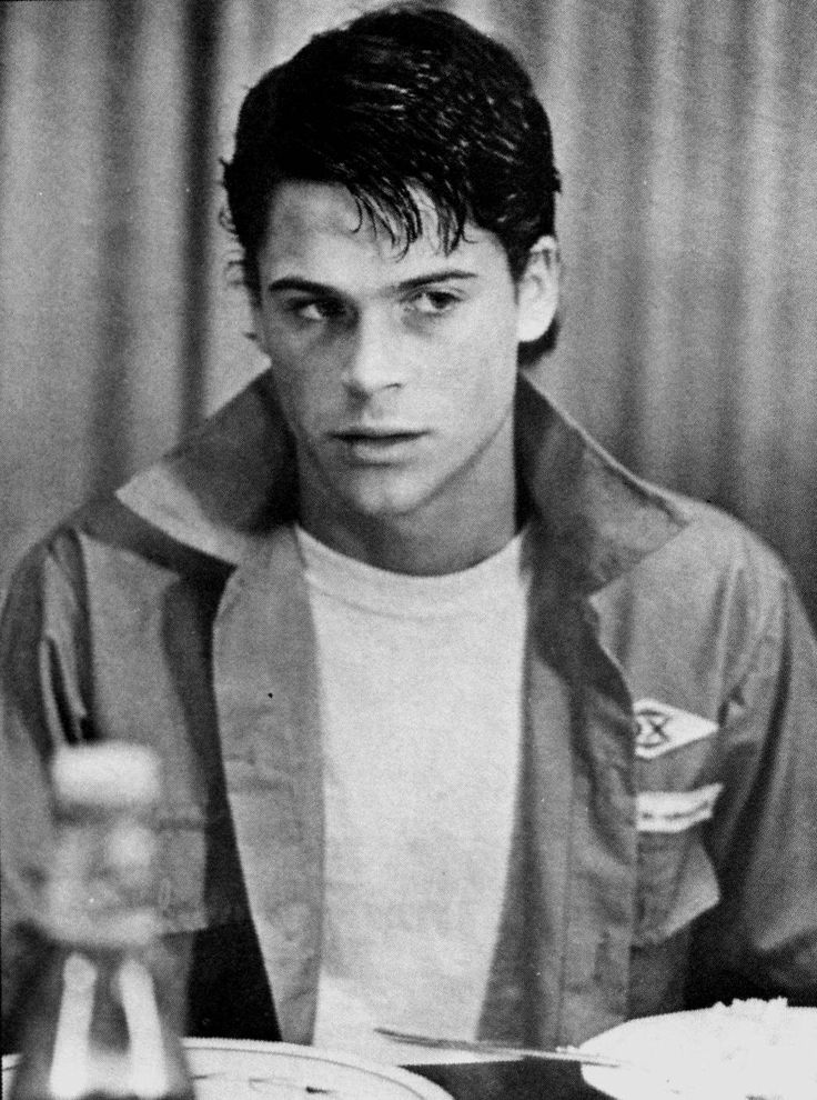 Rob Lowe as Sodapop Curtis on The Outsiders
