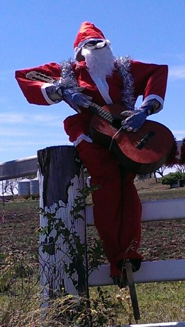 Strumming santa. Looks as if he has been playing hard.