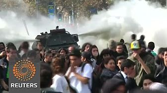 0:45  Chilean students clash with police at education march