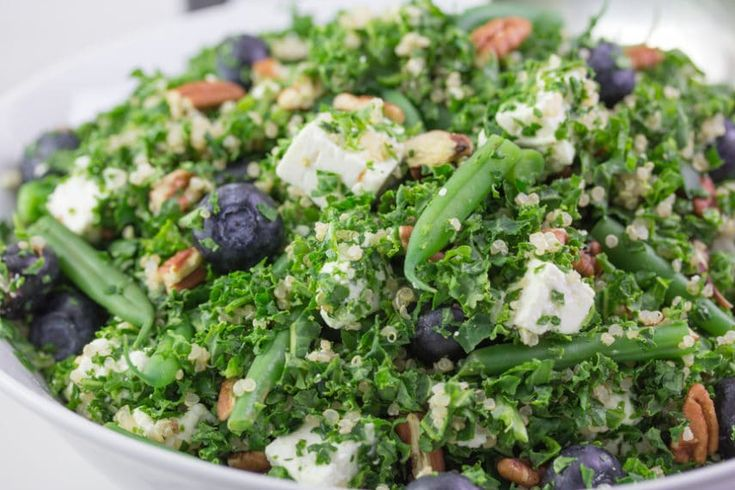 Monash University Certified Low FODMAP Kale Quinoa Salad with Blueberries, Green Beans, Feta & Pecans are a powerhouse combo and beautiful as you can see in this close up shot.
