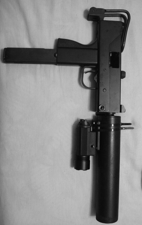 MAC-10 .45 ACP machine pistol with suppressor & laser sight.
