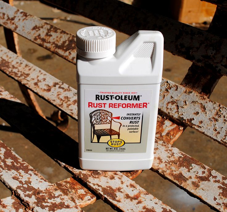 rinsed off the bench, with the hose, to remove any lingering dust or chips and then I applied the Rust-oleum Rust Reformer. Let me tell you this is the first time that I've tried this product before and it is some good stuff!! You just paint it on with a brush. It goes on milky white, but it dries clear. It basically seals in the rust, so that it can't bleed through. After brushing it on, I let it dry overnight. -