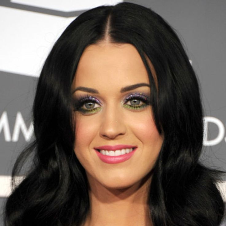 """Find out how Katy Perry has became a pop music singing sensation known for her over-the-top fashions and catchy songs like """"I Kissed a Girl"""", on Biography.com."""
