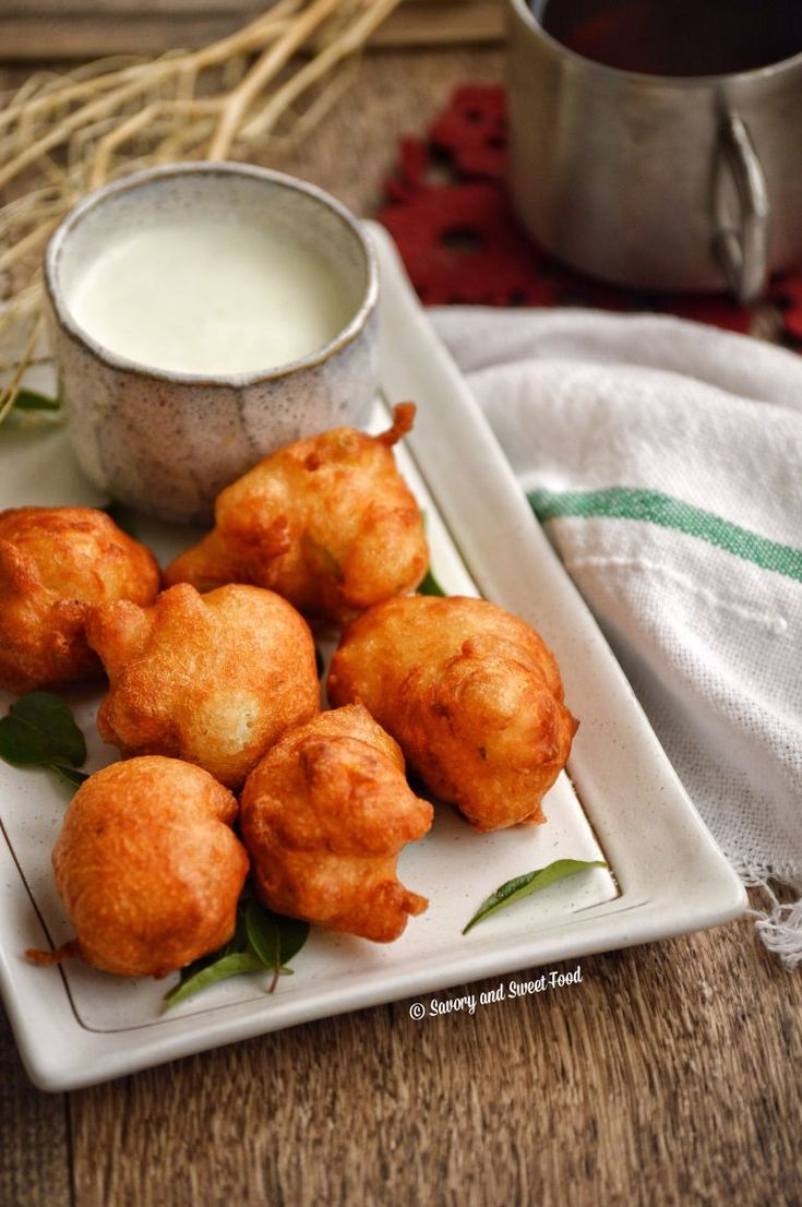 Goli Baje/ Mangalore bajji are deep fried fritters made mainly with all purpose flour, rice flour and yoghurt. It is so addictive and very delicious. The super crispy exterior and the fluffy, pillo…