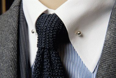 Look out for this style for 2013! Solid color knit ties paired collar bars.