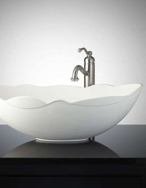 The Subtle Carvings On This Scalloped Rim Vessel Sink Add Visual Interest  To Your Bathroom.