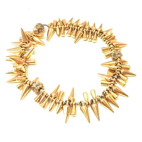 Stella & Dot Renegade Cluster Bracelet Gold renegade cluster spike bracelet from Stella & Dot. It has stretched out a little and is now a little too big for my tiny wrists, so I'll be investing in a new one, but this bracelet is still in great condition! Stella & Dot Jewelry Bracelets