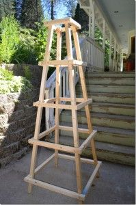 Flower Patch Farmhouse website shares how to build a garden trellis obelisk project.  This is an amazing garden structure that can be built with basic skil