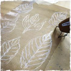 How to make stencils using hot glue on a Teflon sheet.