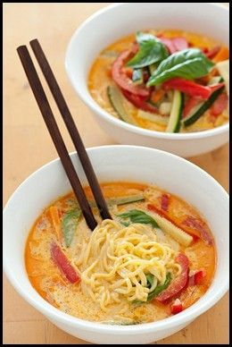 Coconut Curry Noodles    Coconut Curry Noodles    1 Bell Pepper, cut into thin strips    A handful of baby carrots, cut into thin strips    1 jar Thai Kitchen Red Curry Paste    1 can lite coconut milk    1 cup vegetable broth    Rice noodles    Cilantro    Soy sauce, to taste