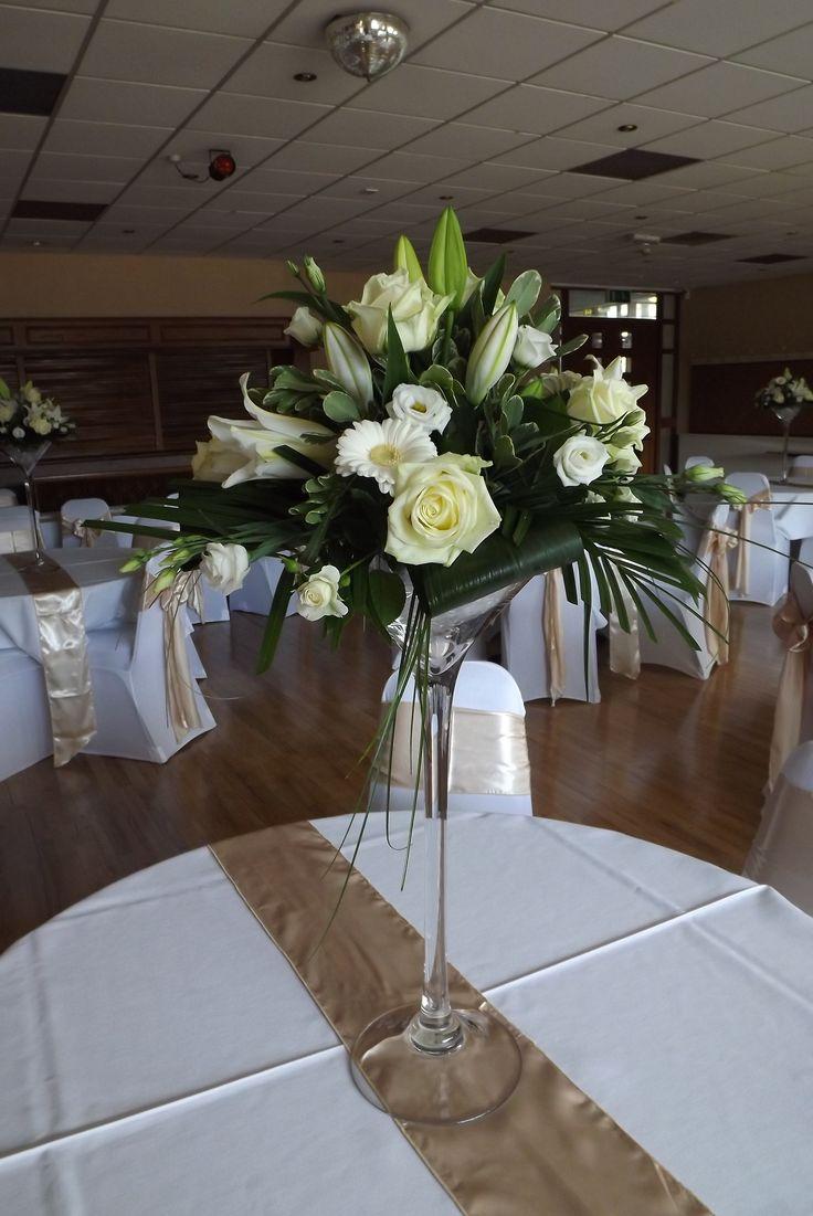 Martini vase arrangments of roses, lilys and lisianathus  www.weddingflowersbylaura.com